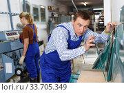 Купить «Man working in glass workshop», фото № 33705349, снято 10 сентября 2018 г. (c) Яков Филимонов / Фотобанк Лори