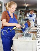 Woman washing glass after cutting. Стоковое фото, фотограф Яков Филимонов / Фотобанк Лори