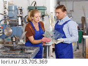 Купить «Male glazier with female apprentice working on drilling machine», фото № 33705369, снято 10 сентября 2018 г. (c) Яков Филимонов / Фотобанк Лори