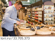 Купить «Male consumer choosing nuts in supermarket», фото № 33705373, снято 9 октября 2019 г. (c) Яков Филимонов / Фотобанк Лори