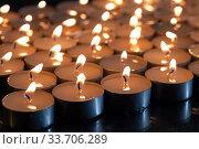 Купить «Many burning candles with shallow depth of field», фото № 33706289, снято 6 мая 2020 г. (c) Яна Королёва / Фотобанк Лори