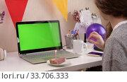 Купить «Woman celebrating birthday from home», видеоролик № 33706333, снято 19 апреля 2020 г. (c) Сергей Петерман / Фотобанк Лори