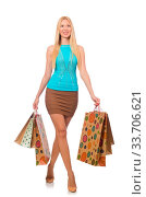Купить «Woman with shopping bags isolated on white», фото № 33706621, снято 7 августа 2020 г. (c) age Fotostock / Фотобанк Лори