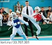 Купить «Orenburg, Russia - October 19, 2019: Boys compete in taekwondo At the Orenburg Open Taekwondo Championship», фото № 33707301, снято 19 октября 2019 г. (c) age Fotostock / Фотобанк Лори