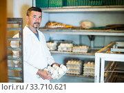 Купить «Man holding carton with eggs», фото № 33710621, снято 4 августа 2020 г. (c) Яков Филимонов / Фотобанк Лори