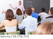 Купить «Confident lecturer talking to mixed age students», фото № 33710713, снято 28 июня 2018 г. (c) Яков Филимонов / Фотобанк Лори