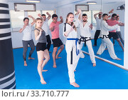 adults attempting to master new moves during karate class. Стоковое фото, фотограф Яков Филимонов / Фотобанк Лори