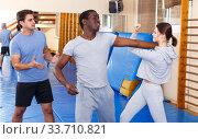 Купить «People fighting with coach at gym», фото № 33710821, снято 31 октября 2018 г. (c) Яков Филимонов / Фотобанк Лори