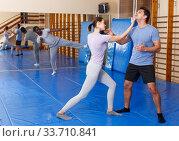 Купить «People practicing self defense techniques», фото № 33710841, снято 31 октября 2018 г. (c) Яков Филимонов / Фотобанк Лори