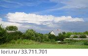 Купить «Beautiful summer rural landscape with cloudy sky», видеоролик № 33711701, снято 18 июля 2018 г. (c) Володина Ольга / Фотобанк Лори