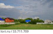 Купить «Beautiful summer rural landscape with cloudy sky», видеоролик № 33711709, снято 18 июля 2018 г. (c) Володина Ольга / Фотобанк Лори