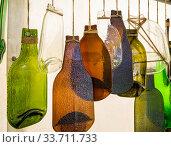 Купить «Поделки изготовленные из стеклянных бутылок после термообработки», фото № 33711733, снято 5 сентября 2019 г. (c) Вячеслав Палес / Фотобанк Лори