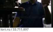 Купить «Mixed race man working at a hat factory», видеоролик № 33711897, снято 16 мая 2019 г. (c) Wavebreak Media / Фотобанк Лори