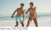 Купить «Caucasian friends training surf styling on the sand », видеоролик № 33712153, снято 25 февраля 2020 г. (c) Wavebreak Media / Фотобанк Лори