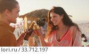 Купить «Caucasian friends enjoying a party on the beach », видеоролик № 33712197, снято 25 февраля 2020 г. (c) Wavebreak Media / Фотобанк Лори