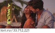 Купить «Caucasian couple cuddling on the beach », видеоролик № 33712221, снято 25 февраля 2020 г. (c) Wavebreak Media / Фотобанк Лори