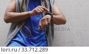 Купить «Front view man with prosthetic leg using his watch», видеоролик № 33712289, снято 13 февраля 2020 г. (c) Wavebreak Media / Фотобанк Лори