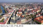 Купить «Panoramic aerial view of autumn Hradec Kralove townscape with Renaissance clock tower and Gothic Cathedral on sunny day, Czech Republic», видеоролик № 33716413, снято 18 октября 2019 г. (c) Яков Филимонов / Фотобанк Лори