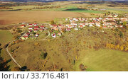 General aerial view of Czech village of Ostrov u Macochy on sunny autumn day, South Moravian Region. Стоковое видео, видеограф Яков Филимонов / Фотобанк Лори
