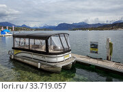 Купить «Empty taxi boat moored to a wooden pier on lake Lucerne. View of the snow-capped Alps. Town of Luzern, canton of Luzern, Switzerland, Europe.», фото № 33719057, снято 16 апреля 2018 г. (c) Bala-Kate / Фотобанк Лори