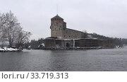 Купить «Средневековая шведская крепость Олафсборг (Олавинлинна) пасмурным мартовским днем. Савонлинна, Финляндия», видеоролик № 33719313, снято 16 марта 2019 г. (c) Виктор Карасев / Фотобанк Лори