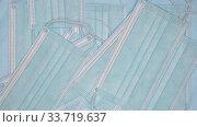 Купить «Slow motion flying surgical face masks. Close-up view of fall lot blue disposable medical respirator bandage for human face», видеоролик № 33719637, снято 2 июля 2020 г. (c) А. А. Пирагис / Фотобанк Лори
