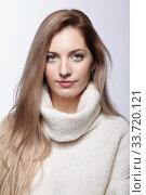 Купить «Blonde woman in woolen sweater», фото № 33720121, снято 4 декабря 2019 г. (c) Serg Zastavkin / Фотобанк Лори