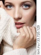 Купить «Blonde young beautiful woman dressed in white woolen sweater .», фото № 33720129, снято 4 декабря 2019 г. (c) Serg Zastavkin / Фотобанк Лори