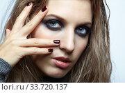 Купить «Blonde young beautiful woman dressed in white woolen sweater.», фото № 33720137, снято 4 декабря 2019 г. (c) Serg Zastavkin / Фотобанк Лори