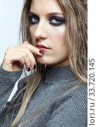 Купить «Blonde young beautiful woman dressed in white woolen sweater.», фото № 33720145, снято 4 декабря 2019 г. (c) Serg Zastavkin / Фотобанк Лори