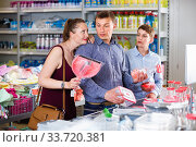 Couple and teenager with household goods purchase. Стоковое фото, фотограф Яков Филимонов / Фотобанк Лори
