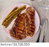 Prepared steak of beef with asparagus at plate. Стоковое фото, фотограф Яков Филимонов / Фотобанк Лори