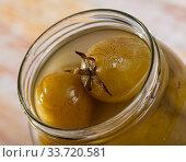 Glass jar with salted green tomatoes. Стоковое фото, фотограф Яков Филимонов / Фотобанк Лори