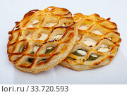 Купить «Tasty bakery pastries with goat cheese and and spinach», фото № 33720593, снято 27 мая 2020 г. (c) Яков Филимонов / Фотобанк Лори