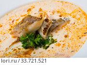 Купить «Tasty creamy soup with white fish pollock and greens at white plate», фото № 33721521, снято 13 июля 2020 г. (c) Яков Филимонов / Фотобанк Лори