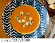 Купить «Boiled vegetarian carrot cream soup served with gorgonzola», фото № 33721589, снято 4 августа 2020 г. (c) Яков Филимонов / Фотобанк Лори