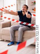 Купить «Young man feeling bored at home in self-isolation concept», фото № 33722197, снято 1 апреля 2020 г. (c) Elnur / Фотобанк Лори