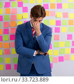 Купить «Young handsome man in conflicting priorities concept», фото № 33723889, снято 17 августа 2018 г. (c) Elnur / Фотобанк Лори