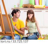 Купить «Young couple enjoying painting at home», фото № 33725137, снято 11 июля 2018 г. (c) Elnur / Фотобанк Лори
