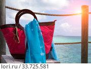 Red beach bag and sun glasses on sea  background. Стоковое фото, фотограф Вознесенская Ольга / Фотобанк Лори