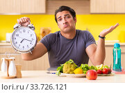 Купить «Young man in dieting and healthy eating concept», фото № 33726121, снято 19 июня 2018 г. (c) Elnur / Фотобанк Лори