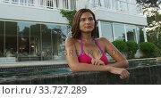 Купить «Caucasian woman enjoying the pool during a sunny day», видеоролик № 33727289, снято 28 ноября 2019 г. (c) Wavebreak Media / Фотобанк Лори