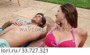Купить «Happy Caucasian couple enjoying the pool during a sunny day», видеоролик № 33727321, снято 28 ноября 2019 г. (c) Wavebreak Media / Фотобанк Лори