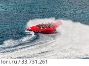 Купить «San Miguel de Cozumel, Mexico - April 25, 2019: View of the Twister Jet Boat ride in harbor of San Miguel de Cozumel, Caribbean. People enjoy the speedboat swerves, jumps and spins!.», фото № 33731261, снято 25 апреля 2019 г. (c) age Fotostock / Фотобанк Лори