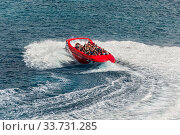Купить «San Miguel de Cozumel, Mexico - April 25, 2019: View of the Twister Jet Boat ride in harbor of San Miguel de Cozumel, Caribbean. People enjoy the speedboat swerves, jumps and spins!.», фото № 33731285, снято 25 апреля 2019 г. (c) age Fotostock / Фотобанк Лори