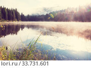 Купить «Misty mountain lake in the early serene morning in mountains.», фото № 33731601, снято 3 июля 2020 г. (c) easy Fotostock / Фотобанк Лори