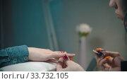 Купить «Doing manicure - applying clear base on the nail», видеоролик № 33732105, снято 3 июля 2020 г. (c) Константин Шишкин / Фотобанк Лори