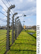 Купить «Barbwire fences at the Birkenau concentration camp which was operated by Nazi Germany in occupied Poland during World War II and the Holocaust.», фото № 33732981, снято 30 октября 2008 г. (c) age Fotostock / Фотобанк Лори