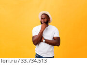 Купить «Human face expressions, emotions and feelings. Handsome young African American man looking up with thoughtful and skeptical expression, holding finger on his chin, trying to remember something», фото № 33734513, снято 9 июля 2020 г. (c) easy Fotostock / Фотобанк Лори