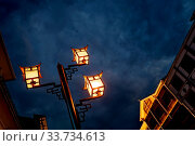 Купить «Brightly lit lamppost on the street in Wulingyuan after dusk at night, Hunan Province, China», фото № 33734613, снято 6 августа 2020 г. (c) easy Fotostock / Фотобанк Лори